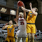SIOUX FALLS, SD - MARCH 8: Damani Hayes #25 of the South Dakota Coyotes battles for a rebound with Grant Nelson #4 of the North Dakota State Bison during the Summit League Basketball Tournament at the Sanford Pentagon in Sioux Falls, SD. (Photo by Dave Eggen/Inertia)