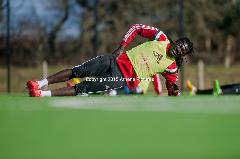 SWANSEA, WALES - FEBRUARY 17: Bafetibis Gomis of Swansea City  warms up  during training session at the Fairwood training ground on February 17, 2015 in Swansea, Wales.  (Photo by Athena Pictures )
