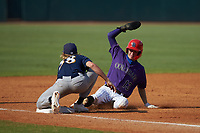 Drake Varnado (13) of IMG Academy in Port Neches, TX playing for the Colorado Rockies scout team slides into third base as pitcher Coleman Willis (38) of Houston County HS in Warner Robins, GA playing for the Milwaukee Brewers scout team applies a late tag during the East Coast Pro Showcase at the Hoover Met Complex on August 5, 2020 in Hoover, AL. (Brian Westerholt/Four Seam Images)