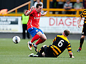 Cowdenbeath's Jamie Stevenson is caught late by Alloa's Stephen Simmons.