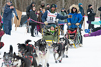 Dennis Kananowicz and team run past spectators on the bike/ski trail near University Lake with an Iditarider in the basket and a handler during the Anchorage, Alaska ceremonial start on Saturday, March 7 during the 2020 Iditarod race. Photo © 2020 by Ed Bennett/Bennett Images LLC