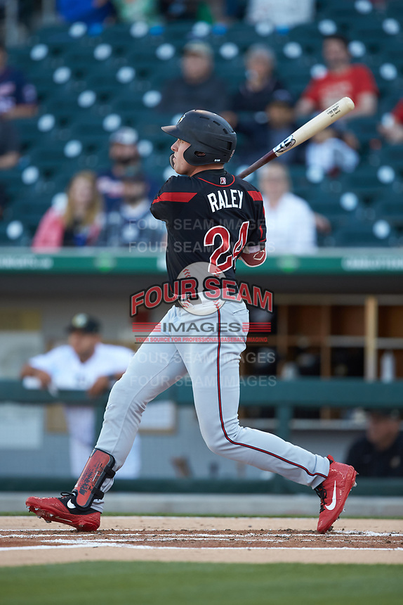 Luke Raley (24) of the Rochester Red Wings follows through on his swing against the Charlotte Knights at BB&T BallPark on May 14, 2019 in Charlotte, North Carolina. The Knights defeated the Red Wings 13-7. (Brian Westerholt/Four Seam Images)