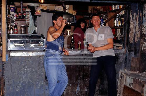 Sao Paulo, Brazil. Favela Vila Prudente shanty town; men drinking at a bar in a shack