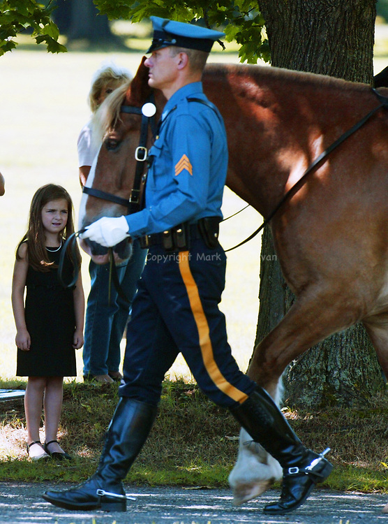 Funeral for North Brunswick Police Lt. Chris Zerby at the Franklin Memorial Park , North Brunswick. Here a young girl watches as New Jersey State Police Sgt. Ted Schafer leads a rider less horse in the funeral precession during the service for the fallen Lt. Chris Zerby.<br /> METRO<br /> 3066<br /> ON SAT AUG.2, 2008<br /> MARK R. SULLIVAN/CHIEF PHOTOGRAPHER