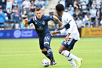 KANSAS CITY, KS - MAY 16: Remi Walter #54 Sporting KC with the ball during a game between Vancouver Whitecaps and Sporting Kansas City at Children's Mercy Park on May 16, 2021 in Kansas City, Kansas.