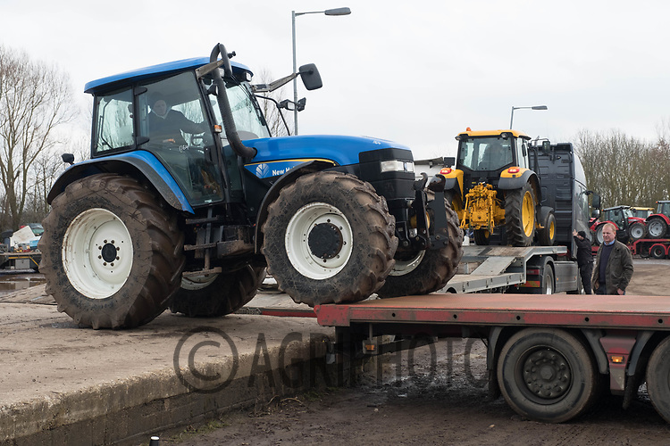 Tractors being loaded onto lorries after an auction<br /> ©Tim Scrivener Photographer 07850 303986<br /> ....Covering Agriculture In The UK....