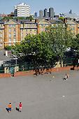 Camden Council housing: boys playing football on Bourne Estate, Holborn