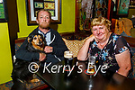 Enjoying a pint and a chat in the reopening of the Saddle Bar in Listowel on Monday, l to r: Gerard Grimes with Cleopatra the dog and Esther McElligott.