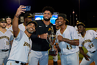 Bradenton Marauders pitching coach Fernando Nieve takes a selfie with pitchers Adrian Florencio (45) and Oliver Mateo (43) after clinching Game Three of the Low-A Southeast Championship Series with a sweep of the Tampa Tarpons on September 24, 2021 at George M. Steinbrenner Field in Tampa, Florida.  (Mike Janes/Four Seam Images)