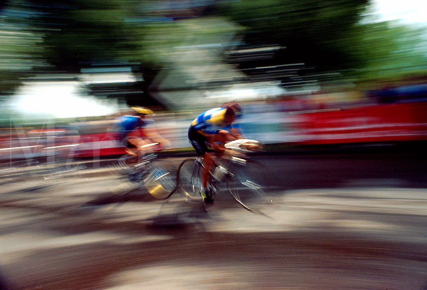Blurred motion image of two cyclists.