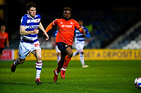 21st April 2021; Kenilworth Road, Luton, Bedfordshire, England; English Football League Championship Football, Luton Town versus Reading; Tom Holmes of Reading chases a long ball with Kazenga LuaLua of Luton Town