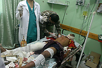 """Palestinian medical workers wheel an injured man into Kamal Edwan hospital in Beit Lahiya, in the northern Gaza Strip, Sunday, Nov. 4, 2007. Israeli aircraft struck in the northern Gaza Strip on Sunday after a rocket attack on Israel, the Israeli military said, and Palestinian hospital officials said three Palestinian civilians were killed, including a father and son. """"phto by Fady Adwan"""""""