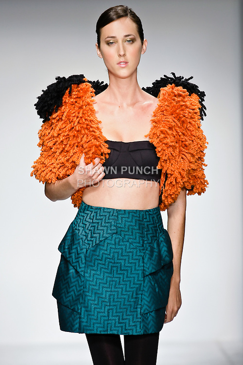 Model walks the runway in an outfit, designed by a Pratt graduating senior, during the Pratt Institute 2010 Fashion Show on May 13, 2010.