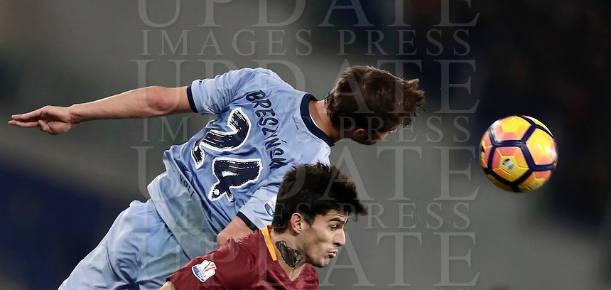 Calcio, ottavi di finale di Tim Cup: Roma vs Sampdoria. Roma, stadio Olimpico, 19 gennaio 2017.<br /> Sampdoria's Bartosz Bereszynski, left, and Roma's Diego Perotti jump for the ball during the Italian Cup round of 16 football match between Roma and Sampdoria at Rome's Olympic stadium, 19 January 2017.<br /> UPDATE IMAGES PRESS/Isabella Bonotto