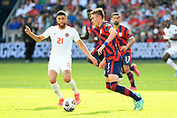 KANSAS CITY, KS - JULY 18: Sam Vines #3 of the United States ,Jonathan Osorio #21 of Canada during a game between Canada and USMNT at Children's Mercy Park on July 18, 2021 in Kansas City, Kansas.