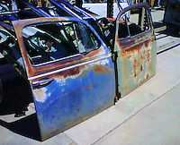 These are the old car doors before I began work on them....who knew they would turn into wonderful and whimsical works of art!