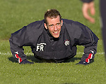 Fernando Ricksen puts on a brave fafter a prankster removed his legs at training