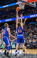 WASHINGTON, DC - DECEMBER 28: Jagan Mosely #4 of Georgetown shoots over Ben Lubarsky #30 of American. during a game between American University and Georgetown University at Capital One Arena on December 28, 2019 in Washington, DC.