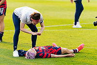 EAST HARTFORD, CT - JULY 5: Rose Lavelle #16 of the United States pretnds to give CPR to teammate Megan Rapinoe #15 after a game between Mexico and USWNT at Rentschler Field on July 5, 2021 in East Hartford, Connecticut.
