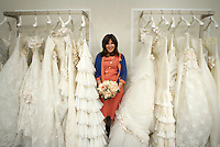 "Wedding planner Mindy Weiss, author of ""The Wedding Book"" poses amid wedding gowns at Kleinfeld's.  110 W. 20 St., NYC.  Newsday/Ari Mintz  4/15/2008."