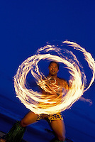 Fire knife dancer is encircled in flames in Kihei, Maui.