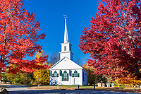 Charming New England church with autumn color.