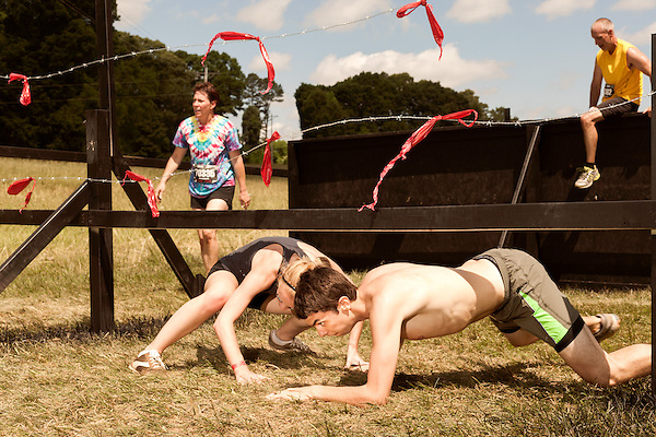 June 1, 2013. Huntersville, North Carolina<br />  One obstacle combined a wall climb, quickly followed by a crawl under barbed wire.<br />  A North Carolina chapter of The Warrior Dash, which consists of a 5k run/walk broken up by several obstacles, was held over the weekend with thousands turning out to test their abilities in a race against the clock and each other. Participants in all age groups were sent out in heats over the course of the entire day.