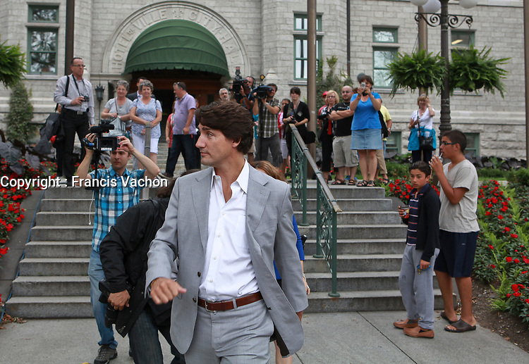 Liberal Party of Canada leader Justin Trudeau leaves the City Hall after meeting with Mayor Regis Labeaume in Quebec City, Thursday August 22, 2013.<br /> <br /> PHOTO :  Francis Vachon - Agence Quebec Presse