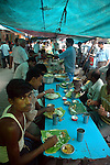 Office workers and  labours all  having meal during break at  a street food stall in Dalhousie area of Kolkata. Street food stalls are serving the office goers for decades. All kind of Indian foods are available on the street at an affordable price. They sale them openly. Street food stalls are another results of unempoloyment and over poppulation. They serve millions of people in India. Kolkata, West Bengal,  India  7/18/2007.  Arindam Mukherjee/Landov