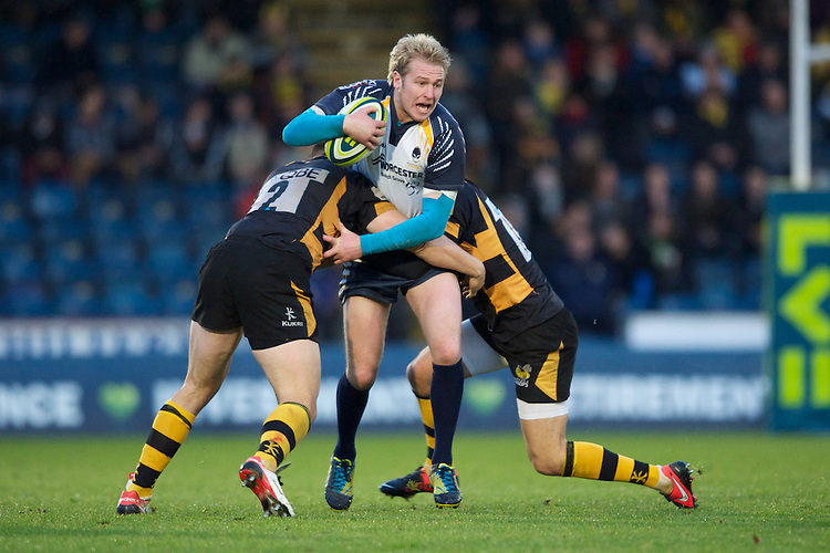 Joe Carlisle of Worcester Warriors is tackled by Tom Lindsay (left) and Tommy Bell of London Wasps during the LV= Cup second round match between London Wasps and Worcester Warriors at Adams Park on Sunday 18th November 2012 (Photo by Rob Munro)