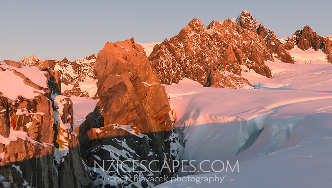 Sunset over Pioneer Hut, Pioneer Ridge and main divide of Southern Alps in upper parts of Fox Glacier NEVE, Westland Tai Poutini National Park, West Coast, UNESCO World Heritage Area, New Zealand, NZ