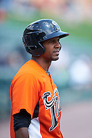 Norfolk Tides outfielder Julio Borbon (5) warms up before a game against the Rochester Red Wings on May 3, 2015 at Frontier Field in Rochester, New York.  Rochester defeated Norfolk 7-3.  (Mike Janes/Four Seam Images)