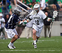 Eric Lusby (12) of Loyola moves through the midfield defended by Francis McDonough (24) of Georgetown at the Ridley Athletic Complex in Baltimore, MD.  Loyola defeated Georgetown, 11-6.
