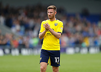 4th September 2021; Merton, London, England;  EFL Championship football, AFC Wimbledon versus Oxford City: A disappointed James Henry of Oxford United applauds the Oxford United fans after full time