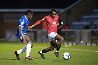 Carlos Mendes Gomes under pressure from Junior Tchamadeu, Colchester United during Colchester United vs Morecambe, Sky Bet EFL League 2 Football at the JobServe Community Stadium on 19th December 2020