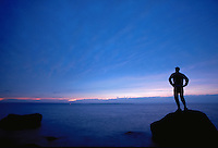 Hiker along the shore of Lake Superior at Apostle Islands National Lakeshore near Ashland, Wisconsin