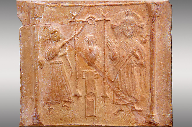 Detail of a 6th-7th Century Eastern Roman Byzantine  Christian Terracotta tiles depicting Christ changing Water into wine - Produced in Byzacena -  present day Tunisia. <br /> <br /> These early Christian terracotta tiles were mass produced thanks to moulds. Their quadrangular, square or rectangular shape as well as the standardised sizes in use in the different regions were determined by their architectonic function and were designed to facilitate their assembly according to various combinations to decorate large flat surfaces of walls or ceilings. <br /> <br /> Byzacena stood out for its use of biblical and hagiographic themes and a richer variety of animals, birds and roses. Some deer and lions were obviously inspired from Zeugitana prototypes attesting to the pre-existence of this province's production with respect to that of Byzacena. The rules governing this art are similar to those that applied to late Roman and Christian art with, in the case of Byzacena, an obvious popular connotation. Its distinguishing features are flatness, a predilection for symmetrical compositions, frontal and lateral representations, the absence of tridimensional attitudes and the naivety of some details (large eyes, pointed chins). Mass production enabled this type of decoration to be widely used at little cost and it played a role as ideograms and for teaching catechism through pictures. Painting, now often faded, enhanced motifs in relief or enriched them with additional details to break their repetitive monotony.<br /> <br /> The Bardo National Museum Tunis, Tunisia.   Against a grey background.