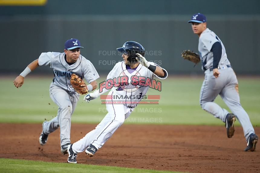 Wilmington Blue Rocks shortstop Cristian Perez (11) chases down Nick Madrigal (3) of the Winston-Salem Dash at BB&T Ballpark on April 16, 2019 in Winston-Salem, North Carolina. The Blue Rocks defeated the Dash 4-3. (Brian Westerholt/Four Seam Images)