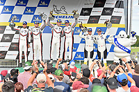 #911 Porsche GT Team Porsche 911 RSR, GTLM: Patrick Pilet, Nick Tandy #912 Porsche GT Team Porsche 911 RSR, GTLM: Earl Bamber, Laurens Vanthoor, #3 Corvette Racing Corvette C7.R, GTLM: Jan Magnussen, Antonio Garcia and Michelin Man  celebrate in victory lane