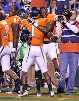 Oct 23, 2010; Charlottesville, VA, USA;  Virginia Cavaliers cornerback Ras-I Dowling (19) celebrates the touchdown of Virginia Cavaliers safety Trey Womack (1) during the 2nd half of the game against Eastern Michigan Eagles at Scott Stadium. Virginia won 48-21. Mandatory Credit: Andrew Shurtleff
