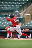 Boston Red Sox Gilberto Jimenez (64) follows through on a swing during a Florida Instructional League game against the Baltimore Orioles on October 8, 2018 at the Ed Smith Stadium in Sarasota, Florida.  (Mike Janes/Four Seam Images)
