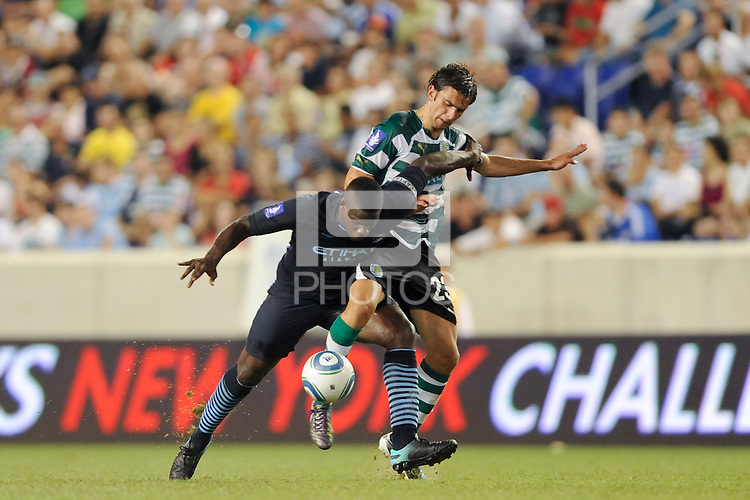 Micah Richards (2) of Manchester City F. C. and Helder Postiga (23) of Sporting Clube de Portugal battle for the ball. Sporting Clube de Portugal defeated Manchester City F. C. 2-0 during a Barclays New York Challenge match at Red Bull Arena in Harrison, NJ, on July 23, 2010.