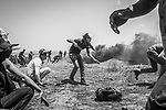 "SHEJAIYA, GAZA: A young Shebab is throwing rocks at Israeli soldiers, the 14th of May 2018. On the 30th of March, Palestinian of Gaza have decided to start the ""Great March of Return"" movement that concist on a sit-in and camps a the borders until the 15th of May, date of Nakba, in order to call for their right of return. <br /> <br /> <br /> SHEJAIYA, GAZA: Un jeune Shebab lance des pierres vers les soldats iraéliens, le 14 mai 2018. Le 30 mars, les Palestiniens de Gaza ont décidé pour lancer le mouvement ""Grande marche du retour"" qui se déroule sur un sit-in et campe aux frontières jusqu'au 15 mai, date de la Nakba, afin de réclamer leur droit au retour."