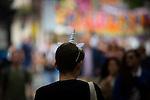© Joel Goodman - 07973 332324 . 26/08/2016 . Manchester , UK . A man wearing a unicorn headband on Canal Street in Manchcester's Gay Village for 2016 Manchester Gay Pride Big Weekend . Photo credit : Joel Goodman