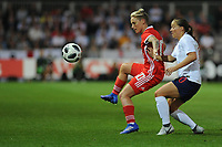 Jess Fishlock of Wales Women battles with Fran Kirby of England Women during the FIFA Women's World Cup Qualifier match between Wales and England at Rodney Parade on August 31, 2018 in Newport, Wales.