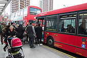 Boarding buses at a bus stop, Shepherds Bush, London