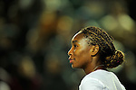 HONG KONG - JANUARY 07: Venus Williams of United States looks on during her match with compatriot Coco Vandeweghe against Jelena Jankovic of Serbia and Michelle Larcher de Brito of Portugal on day one of the World Team Challenge 2009 tournament held at Victoria Park January 7, 2009 in Hong Kong, China.  Photo by Victor Fraile / The Power of Sport Images