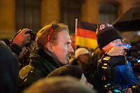 """Etwa 200 Anhaenger des Berliner Ablegers rechten Pegida-Bewegung, Baergida, versammelten sich am Montag den 5. Januar 2015 in Berlin zu einer Demonstration gegen eine angebliche Islamisierung Deutschlands und dagegen, dass """"in 30 Jahren in Deutschland die Sharia herrscht"""", so der Organisator Karl Schmitt.Bis zu 5.000 Menschen protestierten gegen den rechten Ausmarsch und blockierten bei Regen die Marschroute mehrere Stunden. Die Polizei schaffte es nicht mit koerperlicher Gewalt die Blockade zu beenden, so dass die Rechten nach drei Stunden nach Hause gehen mussten. Die Baergida-Anhaenger, """"Berlin gegen die Islamisierung des Abendlandes"""", feierten dies aber dennoch als Sieg. Waren zur ersten Baergida-Aktion eine Woche zuvor nur 5 Menschen gekommen.<br /> Unter den Anhaengern von Baergida waren viele bekannte militante Neonazis und Hooligans sowie Mitglieder der Rechtsparteien AfD und Pro Deutschland und der rechtsradikalen German Defense League. Immer wieder wurde skandiert """"Luegenpresse, auf die Fresse"""" und dass die Journalisten nach Israel verschwinden sollen.<br /> Im Bild: Das Berliner NPD-Mitglied Jan Sturm.<br /> 5.1.2015, Berlin<br /> Copyright: Christian-Ditsch.de<br /> [Inhaltsveraendernde Manipulation des Fotos nur nach ausdruecklicher Genehmigung des Fotografen. Vereinbarungen ueber Abtretung von Persoenlichkeitsrechten/Model Release der abgebildeten Person/Personen liegen nicht vor. NO MODEL RELEASE! Nur fuer Redaktionelle Zwecke. Don't publish without copyright Christian-Ditsch.de, Veroeffentlichung nur mit Fotografennennung, sowie gegen Honorar, MwSt. und Beleg. Konto: I N G - D i B a, IBAN DE58500105175400192269, BIC INGDDEFFXXX, Kontakt: post@christian-ditsch.de<br /> Bei der Bearbeitung der Dateiinformationen darf die Urheberkennzeichnung in den EXIF- und  IPTC-Daten nicht entfernt werden, diese sind in digitalen Medien nach §95c UrhG rechtlich geschuetzt. Der Urhebervermerk wird gemaess §13 UrhG verlangt.]"""