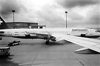 Switzerland. Zürich Airport. Planes at gates. Swissair flight on the tarmac. Swissair was the former national airline of Switzerland. For most of its 71 years, Swissair was one of the major international airlines and was regarded as a Swiss national symbol and icon. The airline was declared bankrupt on March 31 2002. © 2001 Didier Ruef