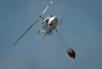A helicopter of the fire work around the area where a fire burns in Montserrat, on July 02, 2012, near Valencia.(c)  Pedro ARMESTRE